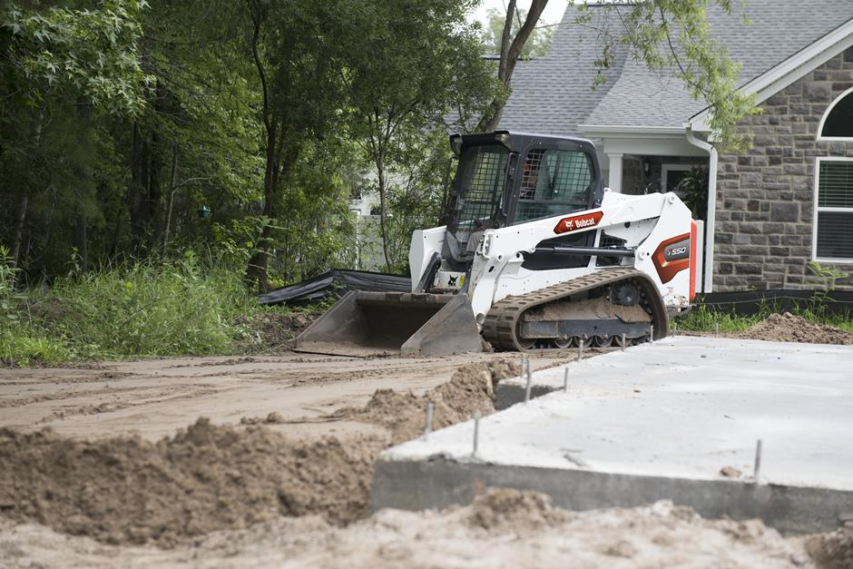 Bobcat T550 Grading Driveway On Residential Construction Site