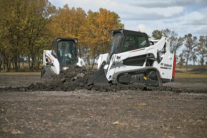 Bobcat T550 and T590 compact track loaders pushing dirt.
