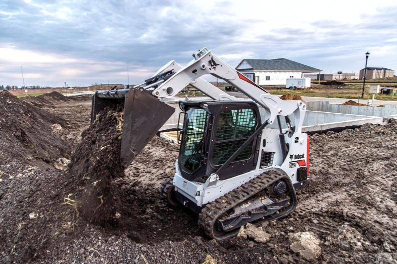 Bobcat T595 compact track loader with land plane attachment.