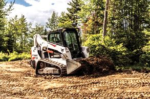 Pair of Bobcat compact track loaders moving on jobsite