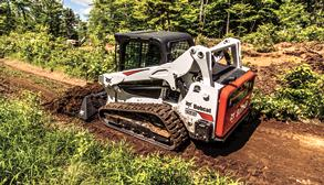Bobcat T595 compact track loader moves dirt with the landplane attachment.