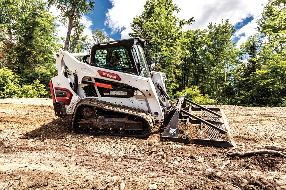 Bobcat T595 With Landplane Attachment Leveling Ground On Worksite