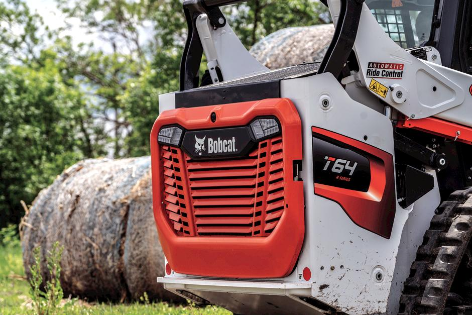 R-Series Compact Track Loader Moving Material With Industrial Grapple Loader Attachment