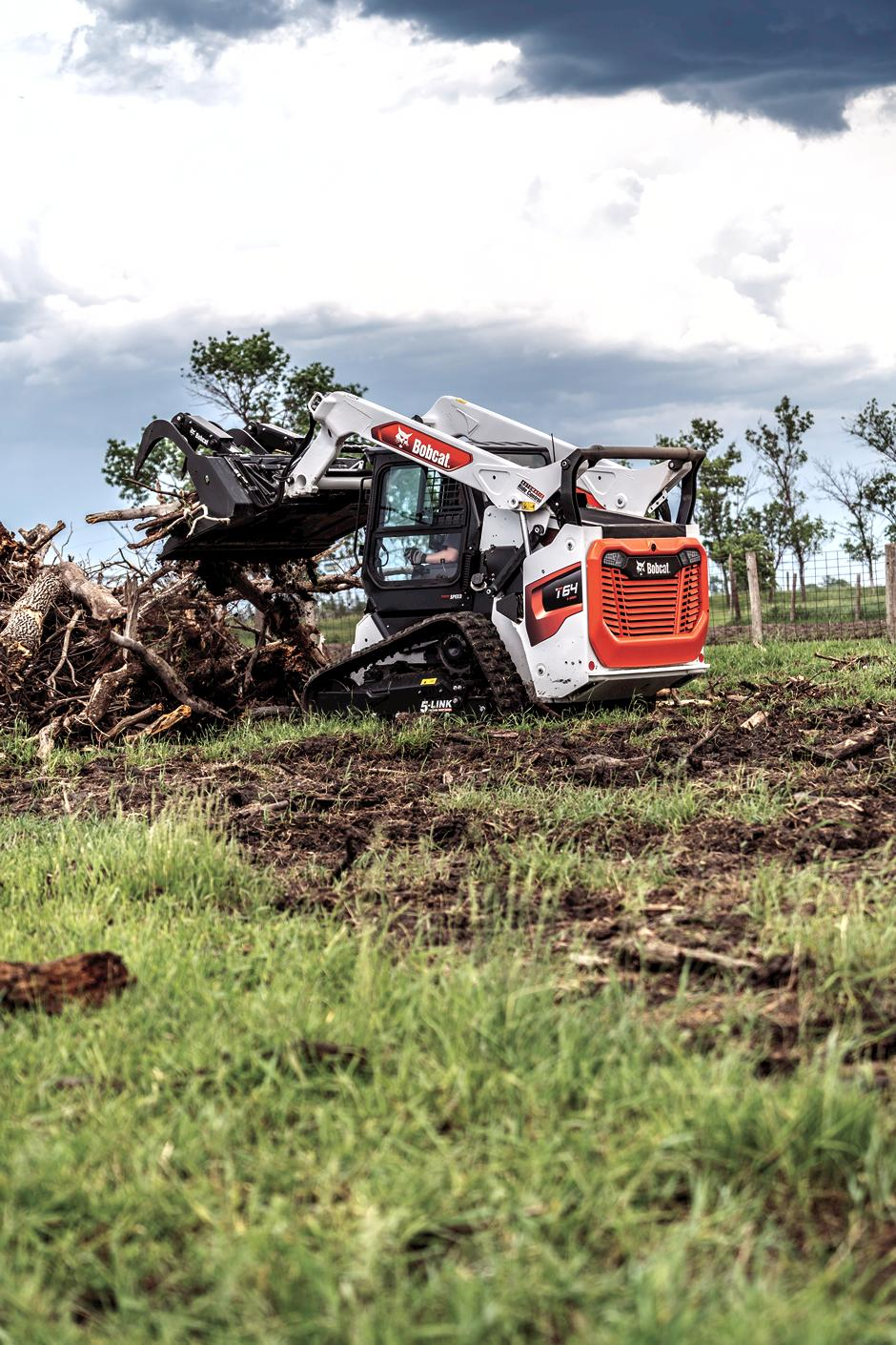 Landscaper Uses A T64 Compact Track Loader With An Industrial Grapple To Pile Up Brush