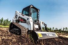 Bobcat T650 compact track loader with tiller attachment.