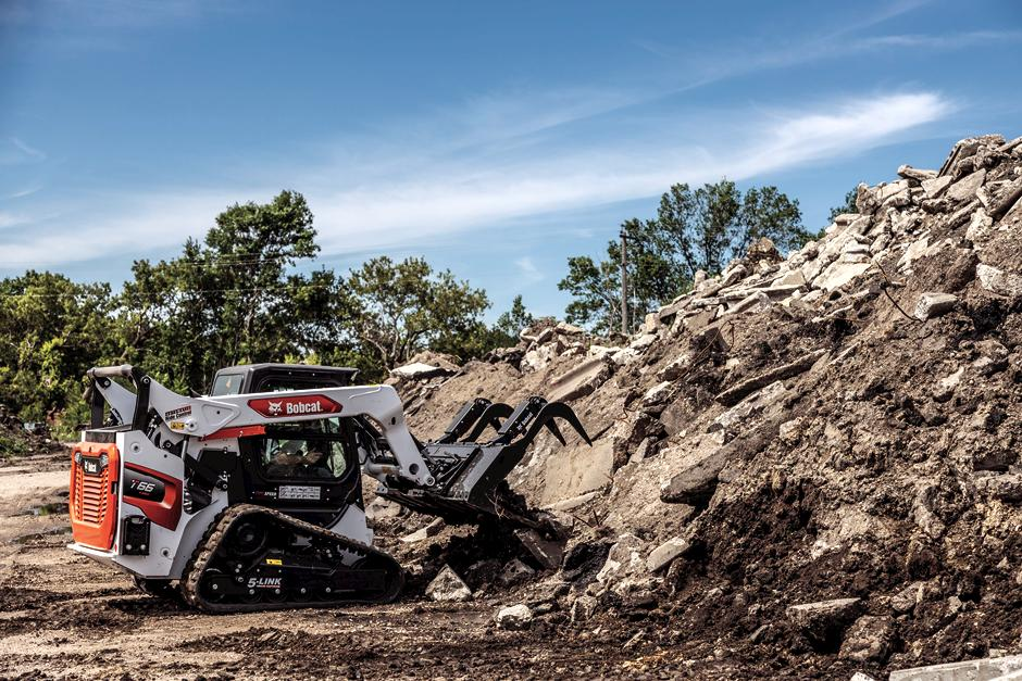 Bobcat T66 Compact Track Loader Moving materials With Industrial Grapple Loader Attachment