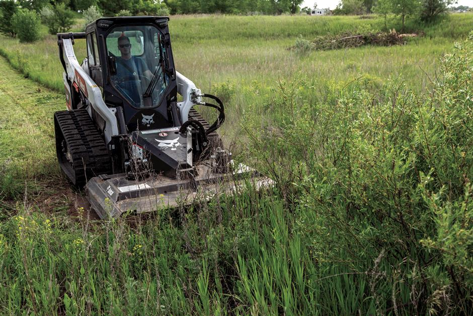 Compact Track Loader With Brushcat Attachment And Removable Hose Guide