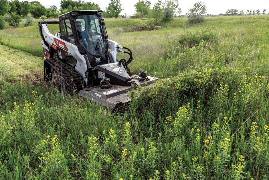 T76 Compact Track Loader Clearing Brush With Loader Attachment