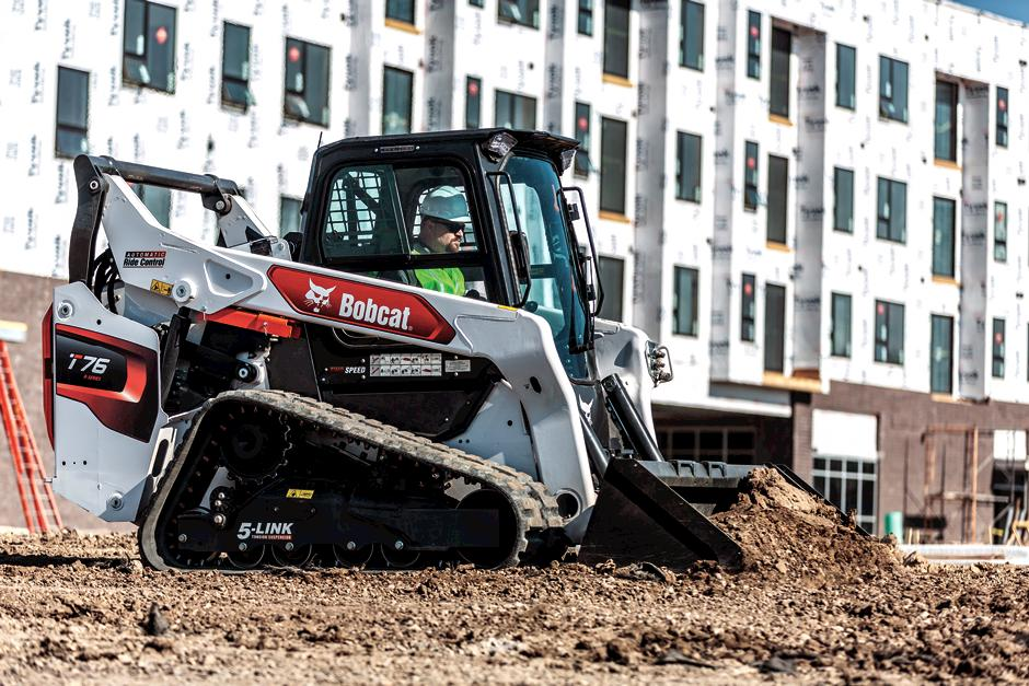 Bobcat Compact Track Loader Using Powerful Hydraulics To Grade On Construction Jobsite