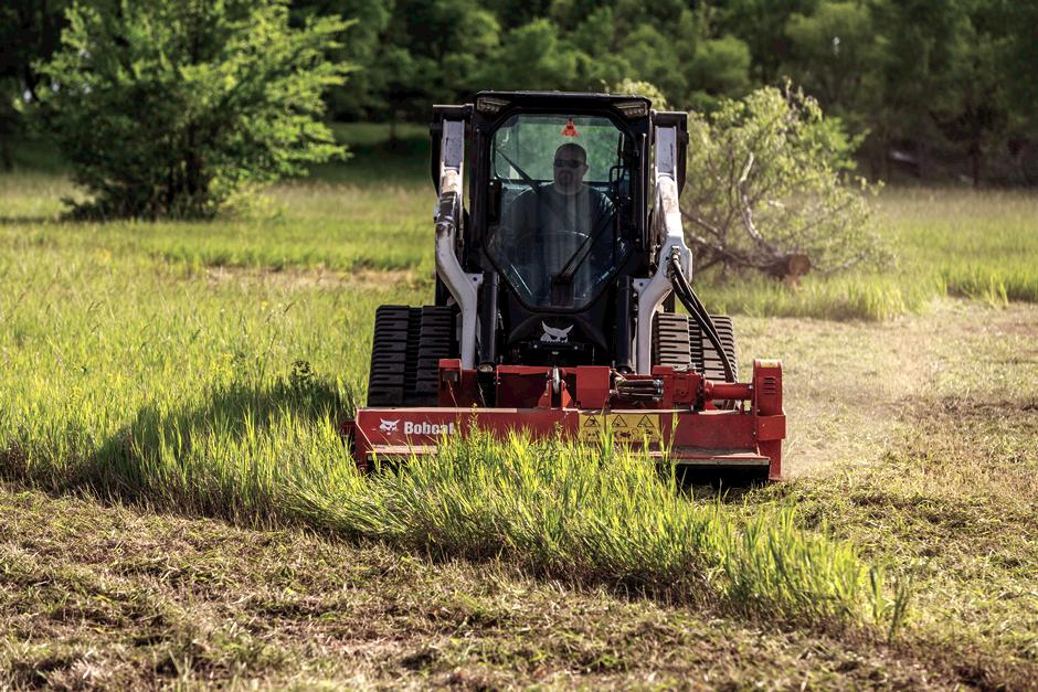 Grounds Maintenance Professional Using Compact Track Loader With Flail Cutter
