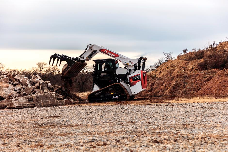 R-Series Loader With Industrial Grapple Moving Rock