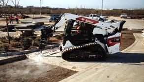 Bobcat R-Series Compact Track Loader With Breaker Attachment In Driveway