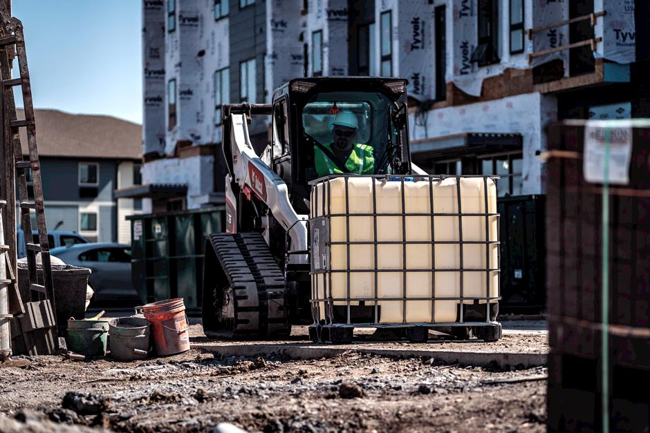 R-Series Compact Track Loader Lifting Heavy Material With Pallet Fork On Construction Site