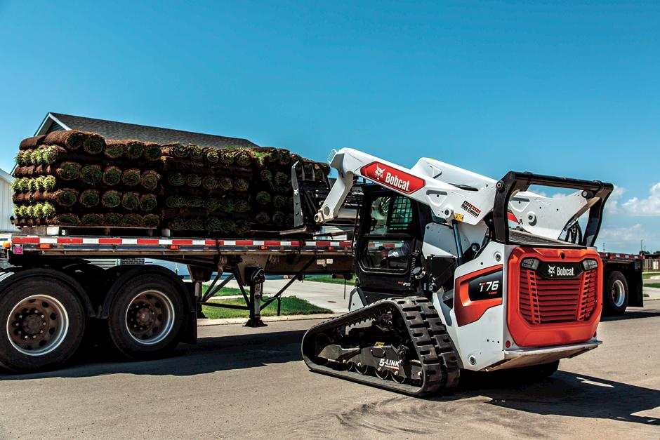 Professional Landscaper Using R-Series Compact Track Loader To Move Sod On Jobsite
