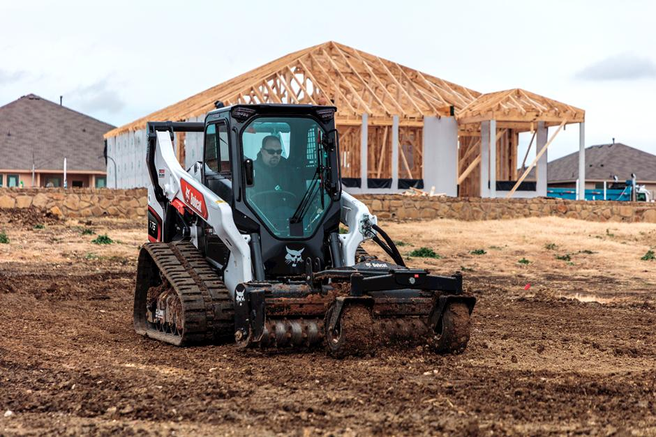 Operator Using R-Series Compact Track Loader To Condition Soil On Construction Jobsite