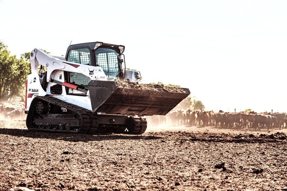 Operator Hauls Dirt With Bucket Attachment On Bobcat T770 Compact Track Loader