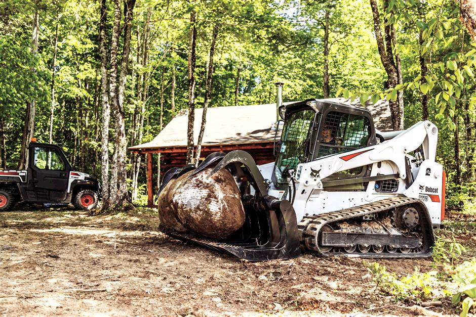 R-Series Compact Track Loader Hauls Material With Root Grapple Attachment