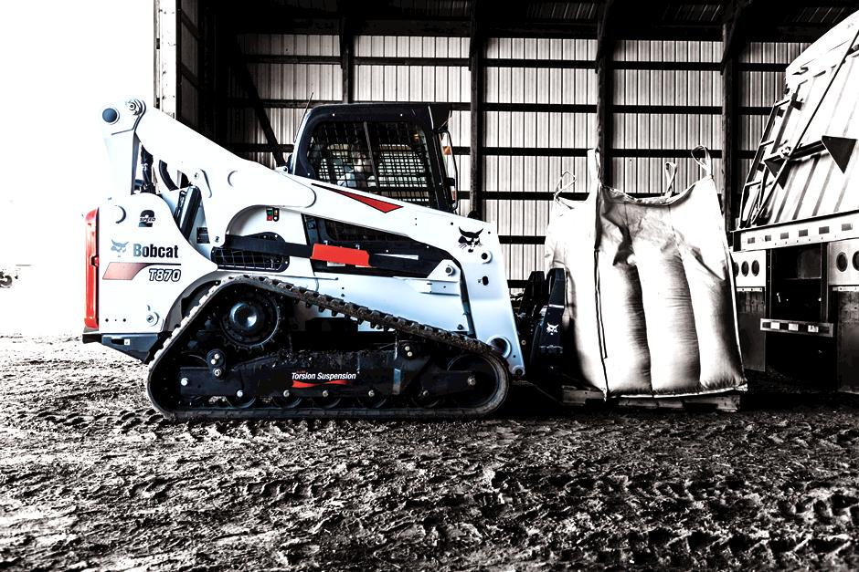 Bobcat T870 with pallet fork attachment.