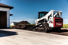 Bobcat T870 compact track loader moving dirt.