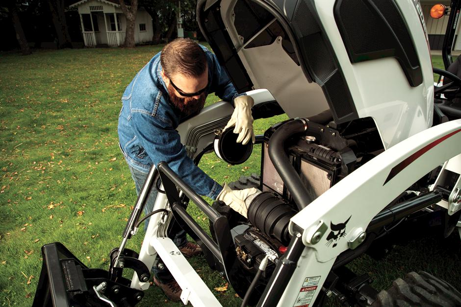 Homeowner Performs Under The Hood Maintenance On Compact Tractor