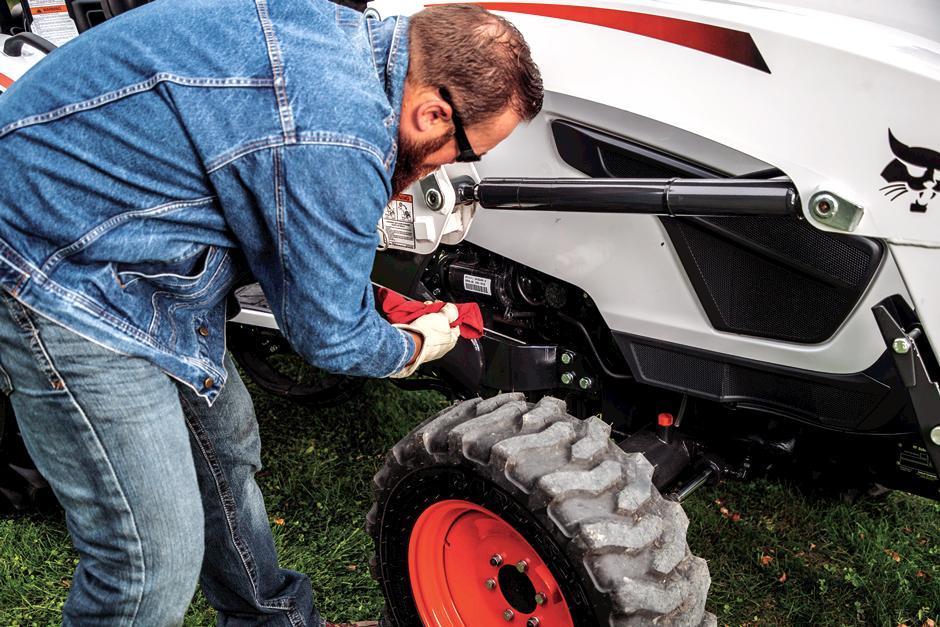 Acreage Owner Checks Bobcat Compact Tractor Oil