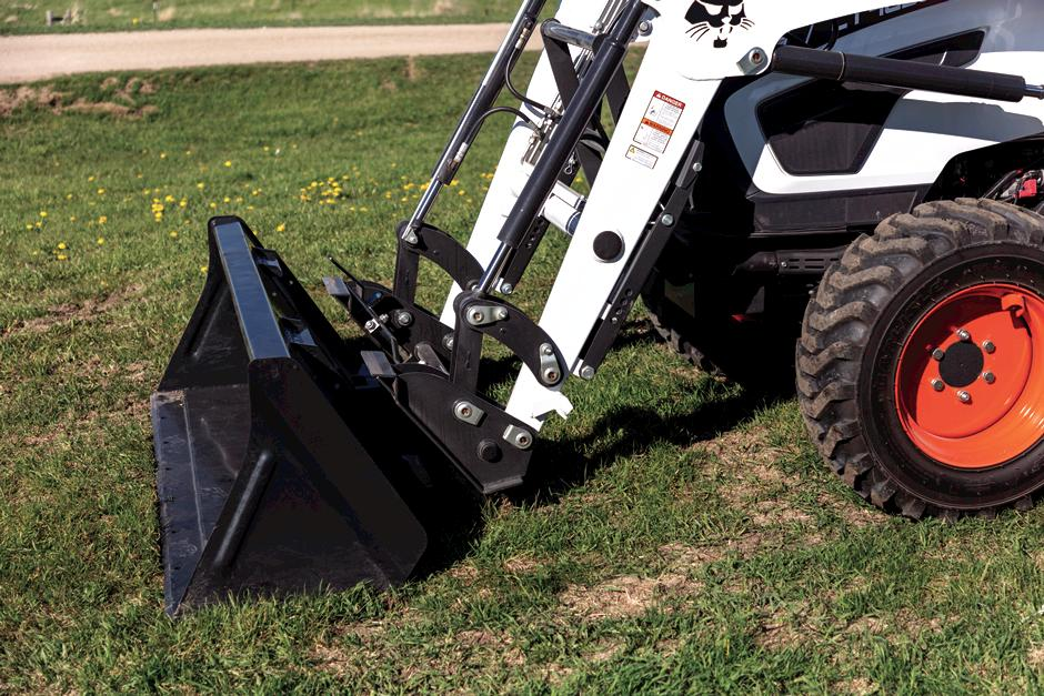 Close-Up Photo Of Front-End Loader With Standard Quick Attach System For Compact Tractor