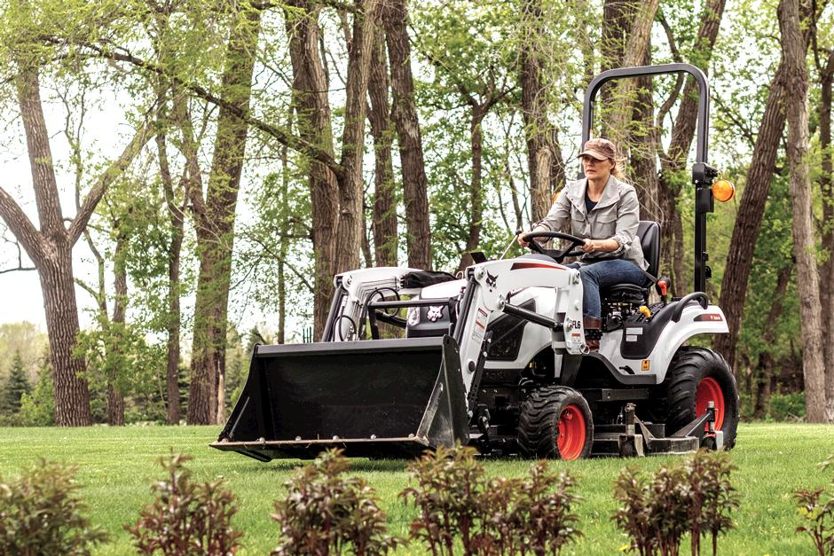 Operator Using Bobcat CT1025 Compact Tractor With Mid-Mount Mower To Mow Lawn