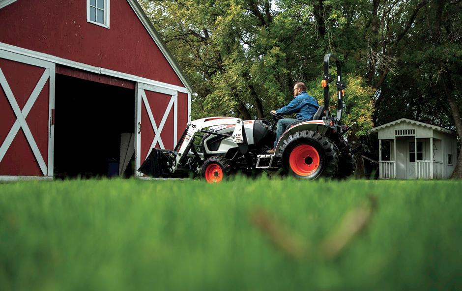 Farmer Drives Bobcat Compact Tractor Into Barn On Acreage