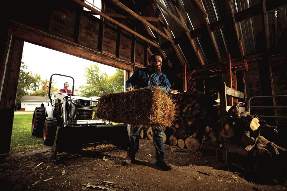 Bocat Compact Tractor in doorway of barn on farm