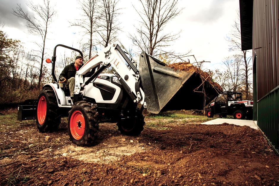Operator Using Front-End Loader On CT2035 Compact Tractor To Dump Soil For Grading Around Building