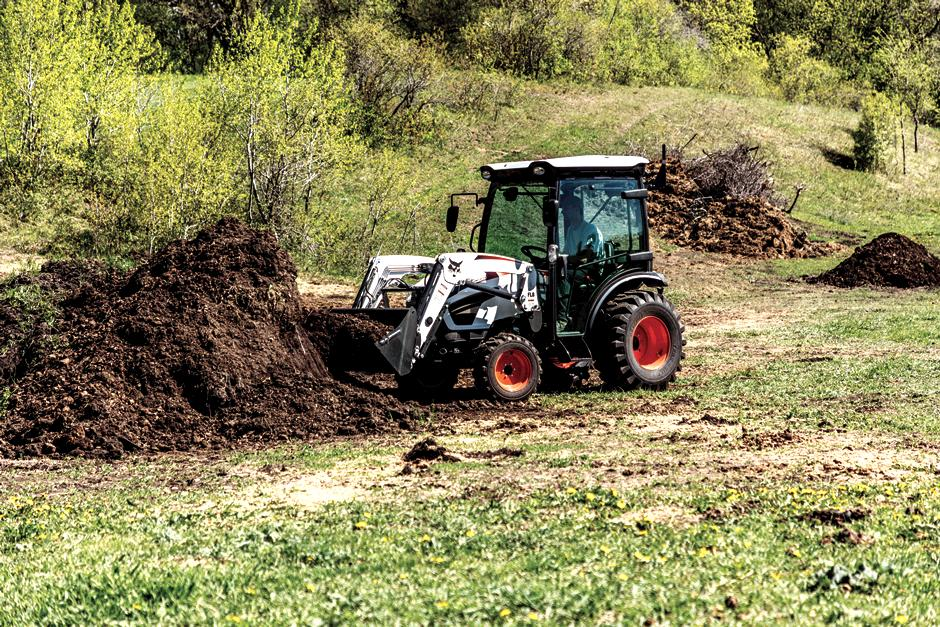 Bobcat CT2535 Compact Tractor Scooping Dirt With A Front-End Loader