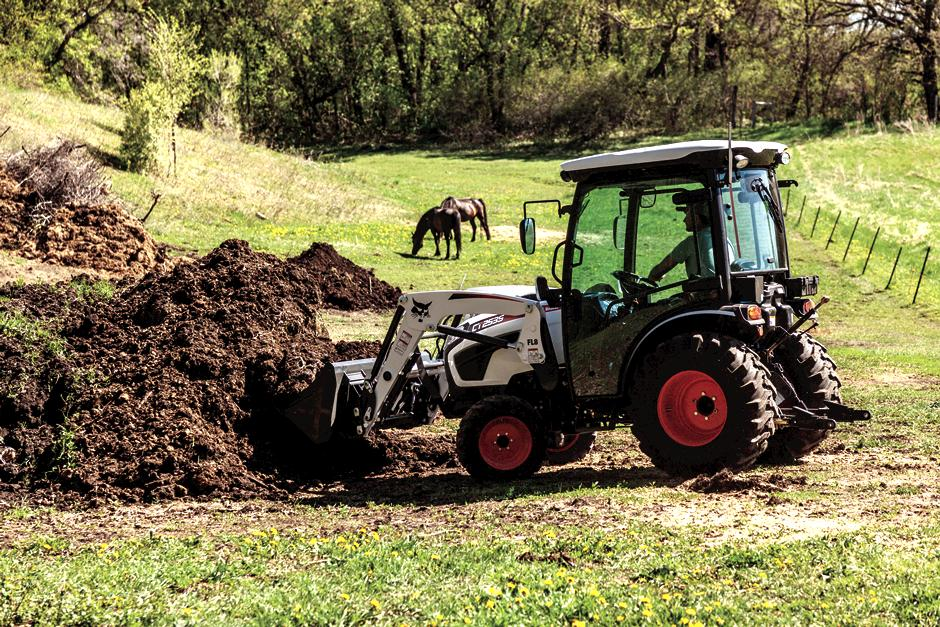 Operator Using Bobcat Compact Tractor With Front-End Loader To Lift Dirt From Pile In Field