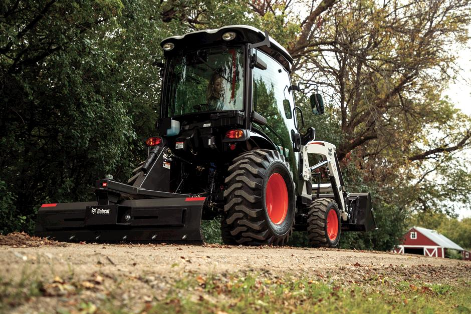 Compact Tractor With Cab Using 3 pt. Angle Blade On Gravel Pathway