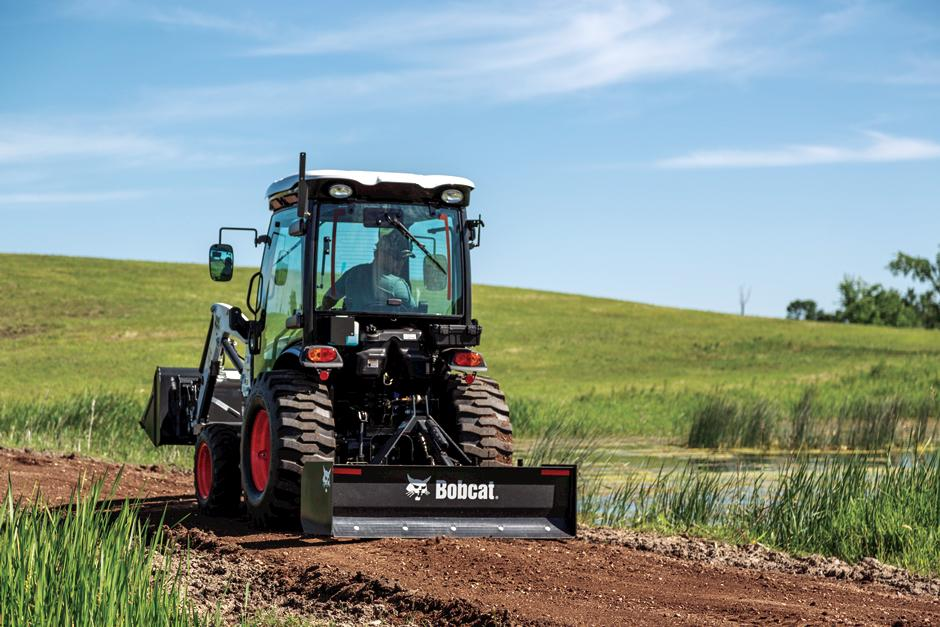 Compact Tractor With Cab Using 3 pt. Box Blade to Level Pathway.