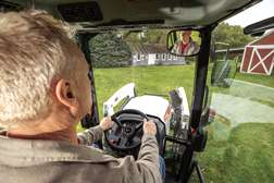Over-The-Shoulder Shot Of An Operator Driving In The Cab Of Bobcat CT2540 Compact Tractor
