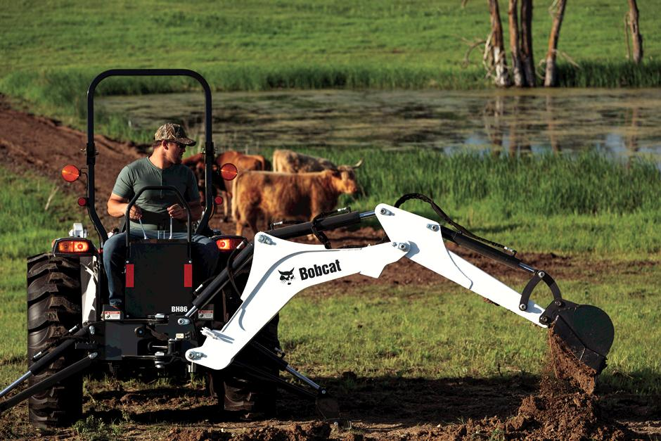 Cattle Farmer Using Bobcat Compact Tractor on Ranch.