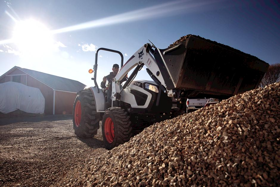 Landscaper Scooping Mulch With Front-End Loader Attachment On CT4045 Compact Tractor
