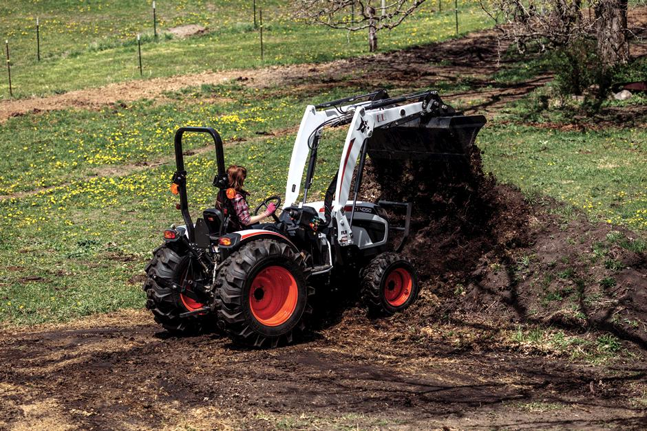 Bobcat Compact Tractor With Front-End Loader Attachment Moving Material