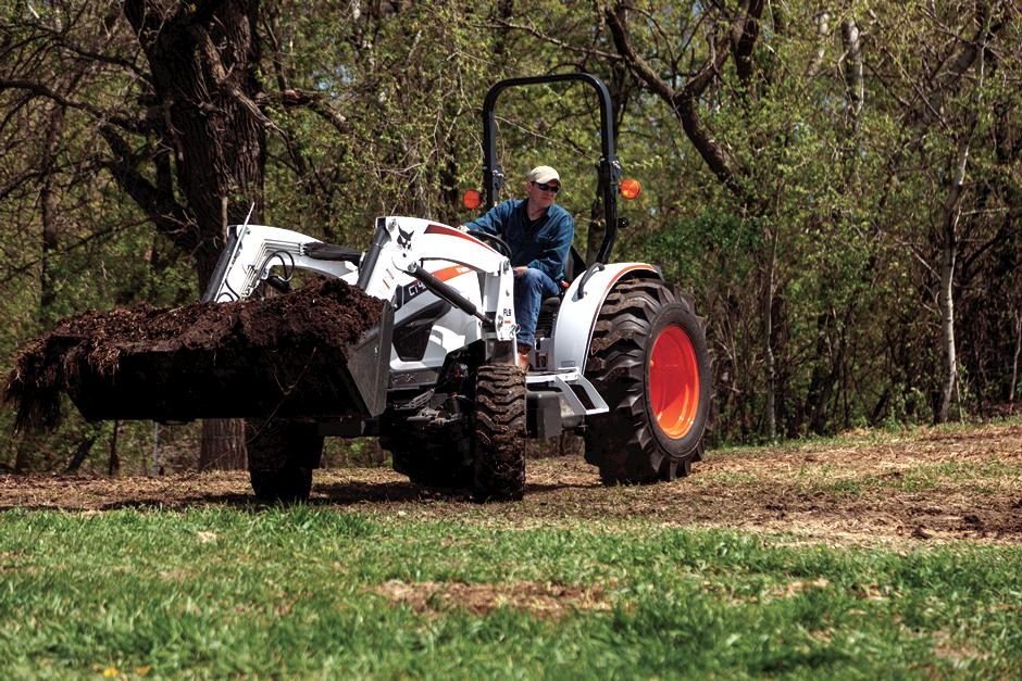 Farmer Using CT4050 Compact Tractor With Front-End Loader To Haul Dirt On Rural Property