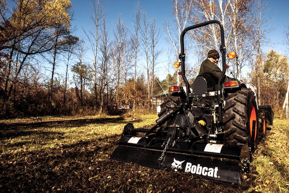 Operator Using A Bobcat CT2035 Compact Tractor With Tiller Implement To Prepare Soil For Food Plot