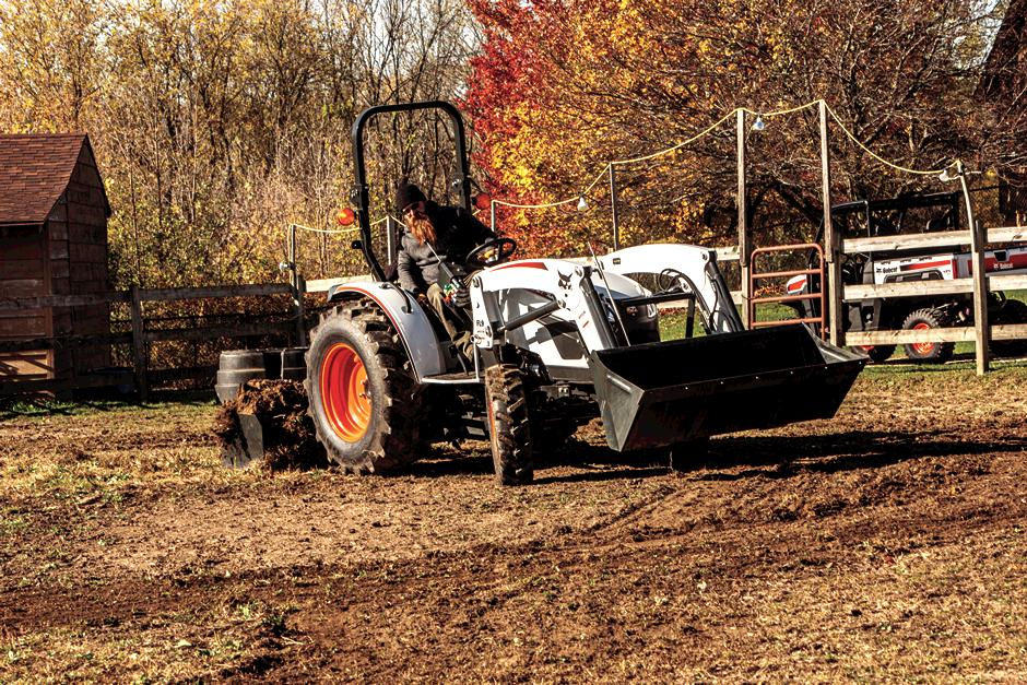 Operator Using A Box Blade Implement On A Bobcat CT4058 Compact Tractor To Grade Riding Arena