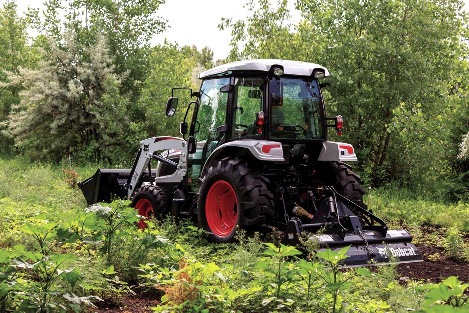 Farmer Uses Bobcat Compact Tractor With Enclosed Cab to Till Land.