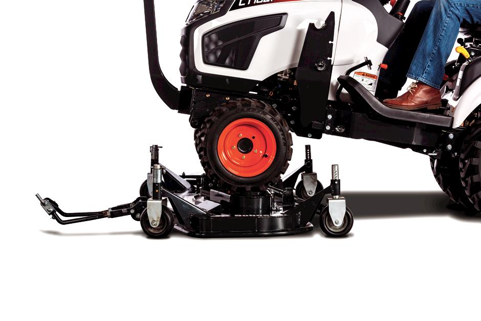 CT1021 Compact Tractor Driving Over Mid-Mount Mower To Attach It