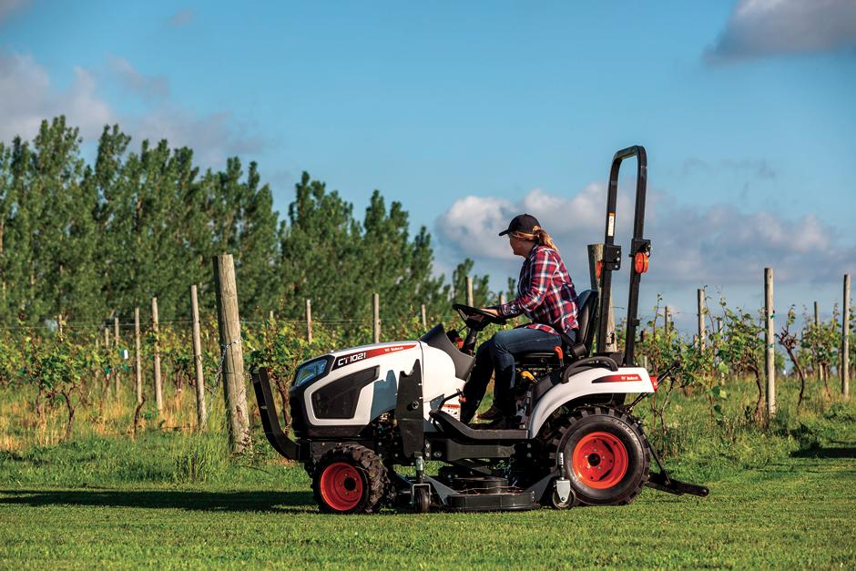 Mid-PTO Powered Mid-Mount Mower On Bobcat Compact Tractor Mowing Vineyard