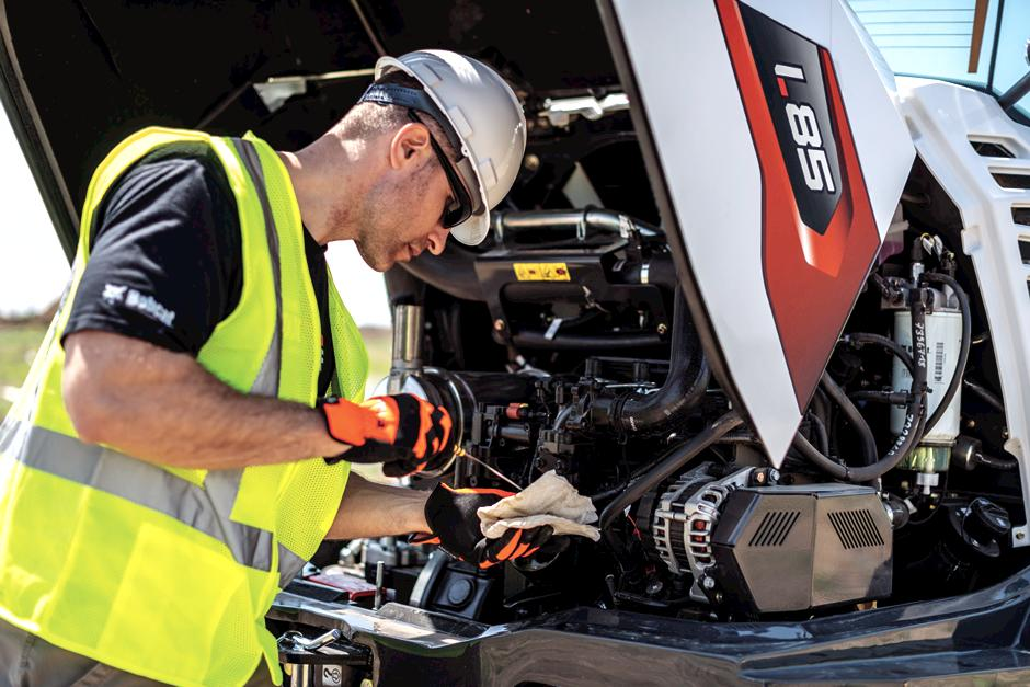 Operator Performs Routine Maintenance To The Bobcat Engine Of a Compact Wheel Loader.
