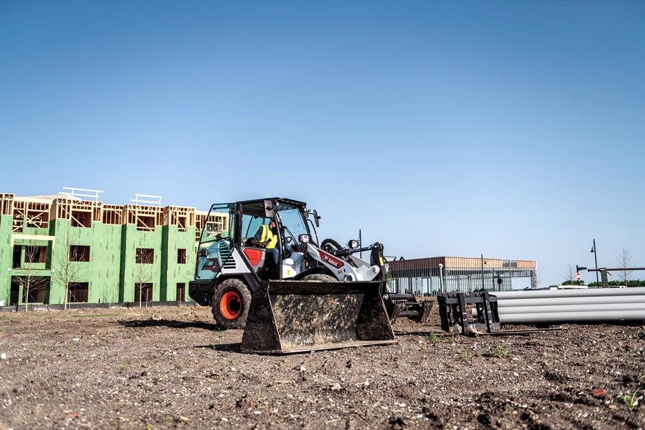 Bobcat L85 Compact Wheel Loader On A Jobsit Switching Between Attachments.