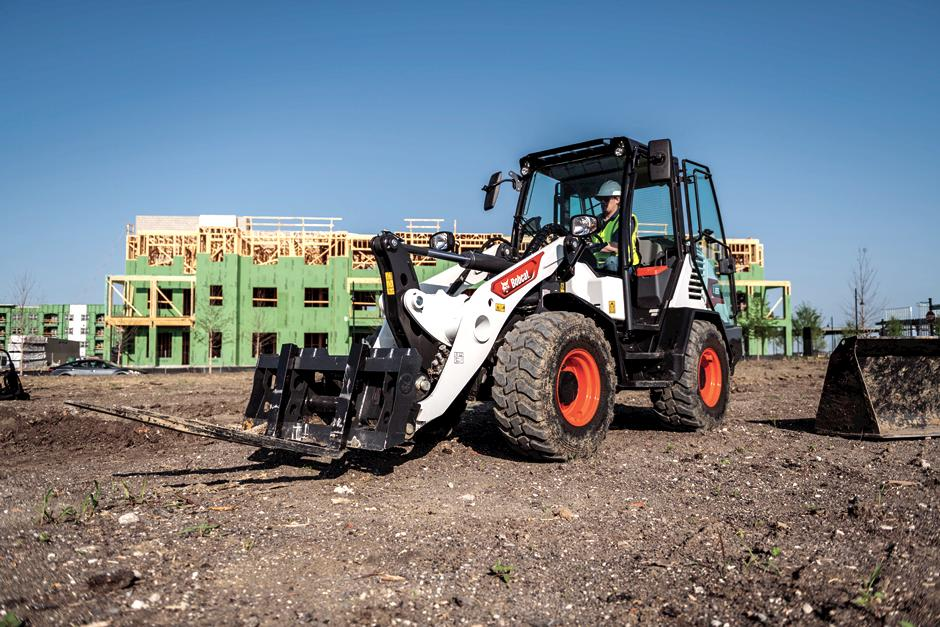 Bobcat L85 Compact Wheel Loader With Pallet Fork Attachment On Jobsite.