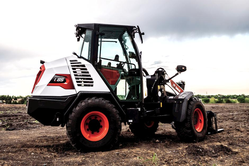 Bobcat L85 Compact Wheel Loader Turns To the Left On Dirt Jobsite.