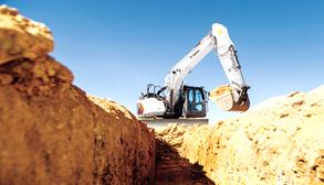 Bobcat E145 Excavator digging a trench