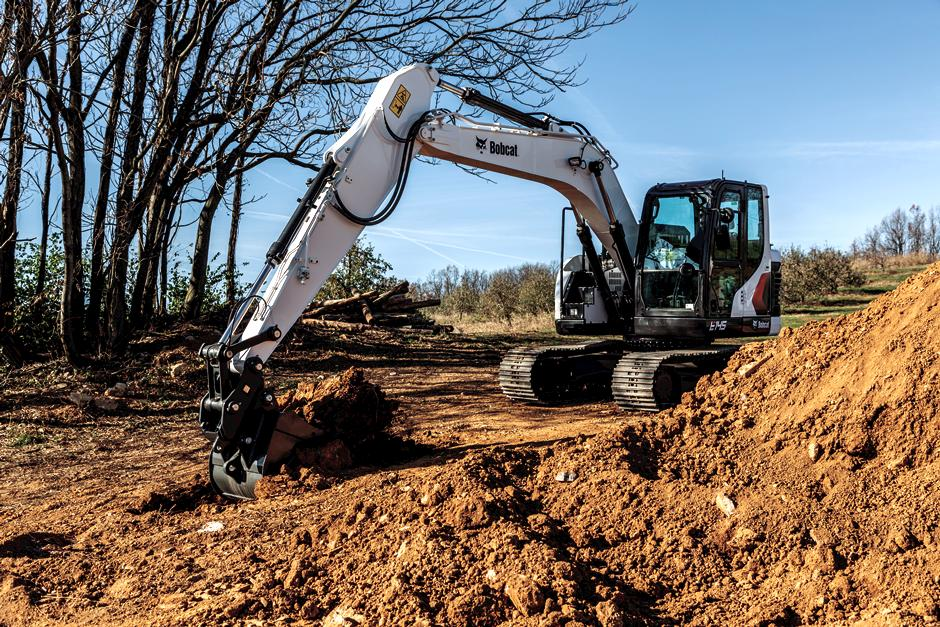 Bobcat 14-16T Size Class Large Excavator Digging Dirt On Construction Jobsite
